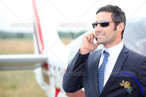 Photodune - Executive standing in front of his private plane 1703217