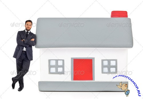 Photodune - Businessman leaning against a miniature house 6897409