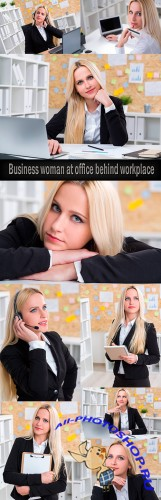 Business woman at office behind workplace