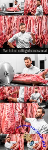 Man behind cutting of carcass meat