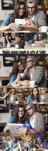 Happy young couple in cafe at table