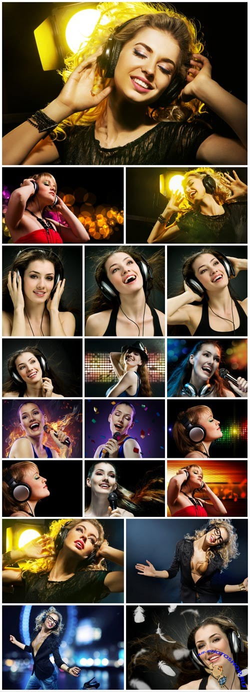 Girls with headphones listening to music and singing stock photo